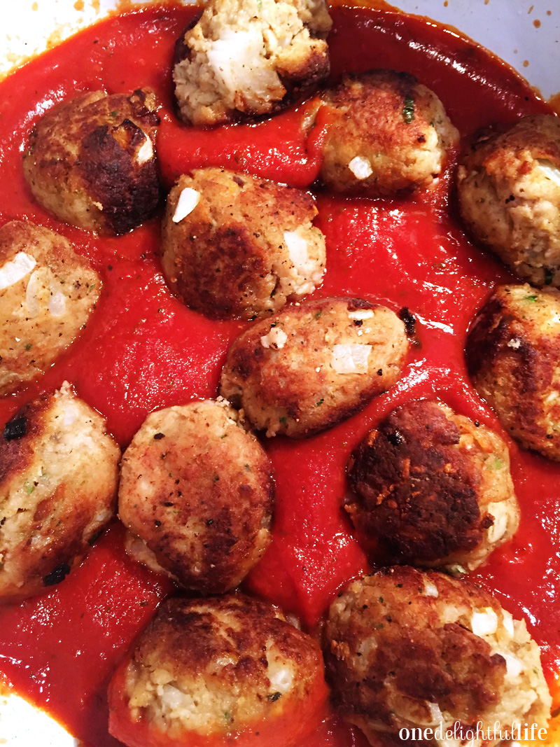 Use a spoon to gently and evenly coat the sauce on the meatballs.