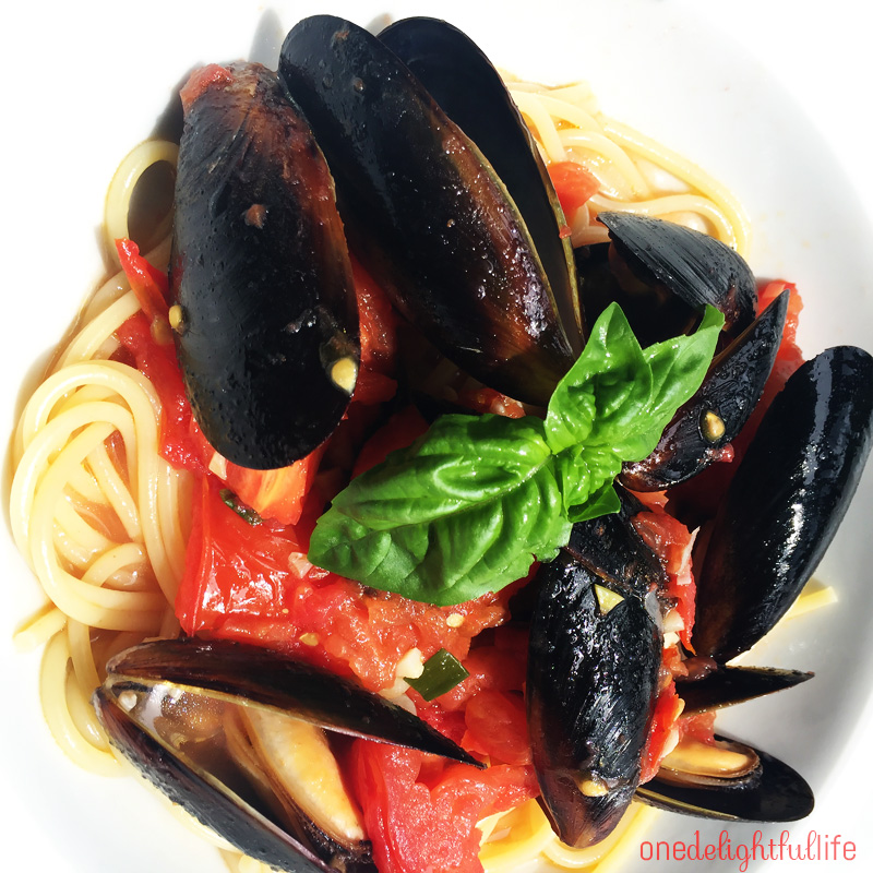 Rinse these pre-cooked, frozen mussels in a colander before adding them to the pomodoro sauce.