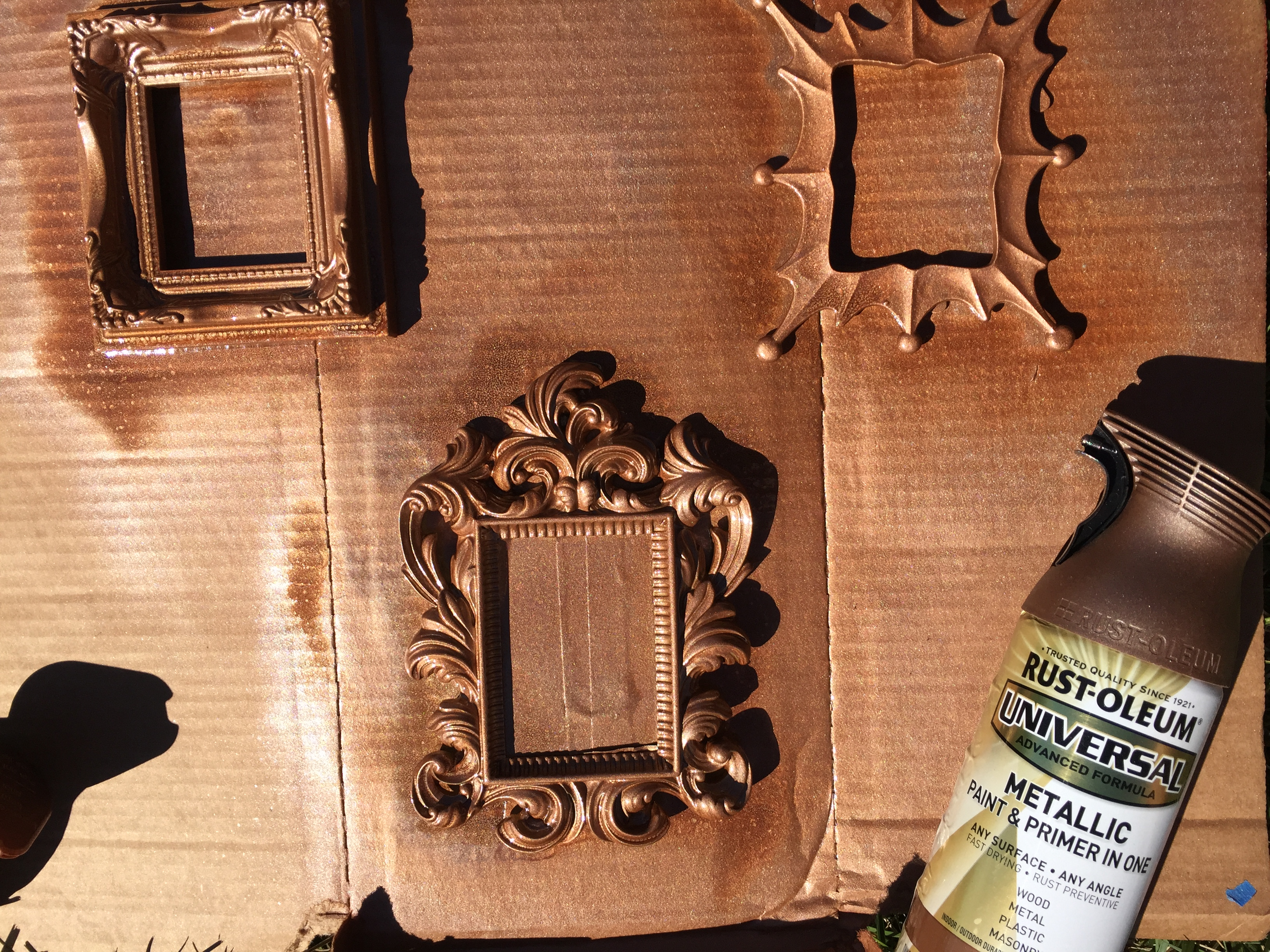 Step 3: Make sure you're working in a well ventilated area before spraying frames. If so, spray an even coat of your favorite color of metallic spray paint and primer in one. I LOVE this spray paint because it applies evenly and never requires a second coat. Easy!