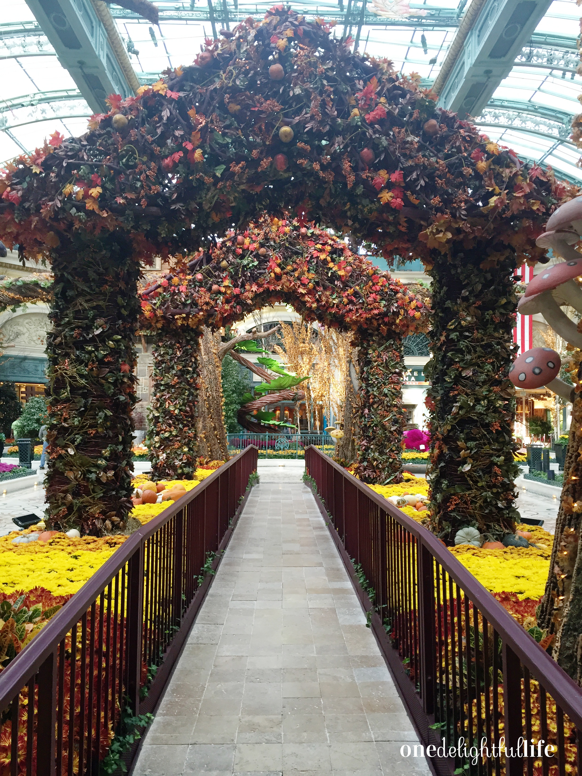 Main entrance to the conservatory gardens. Bellagio staff works on the flowers during early morning hours.