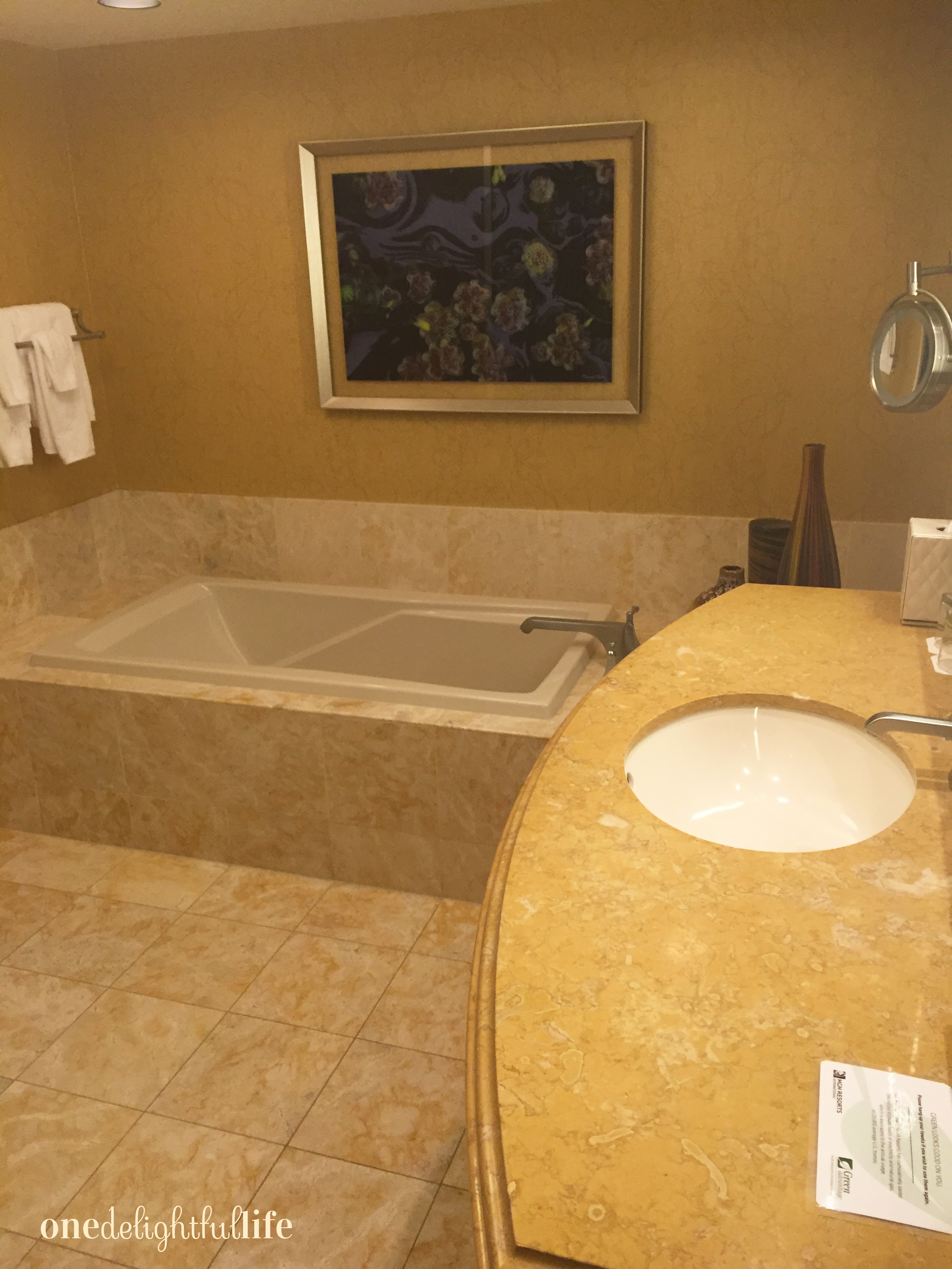 Each bathroom comes with a large glass enclosed shower and deep bathtub.