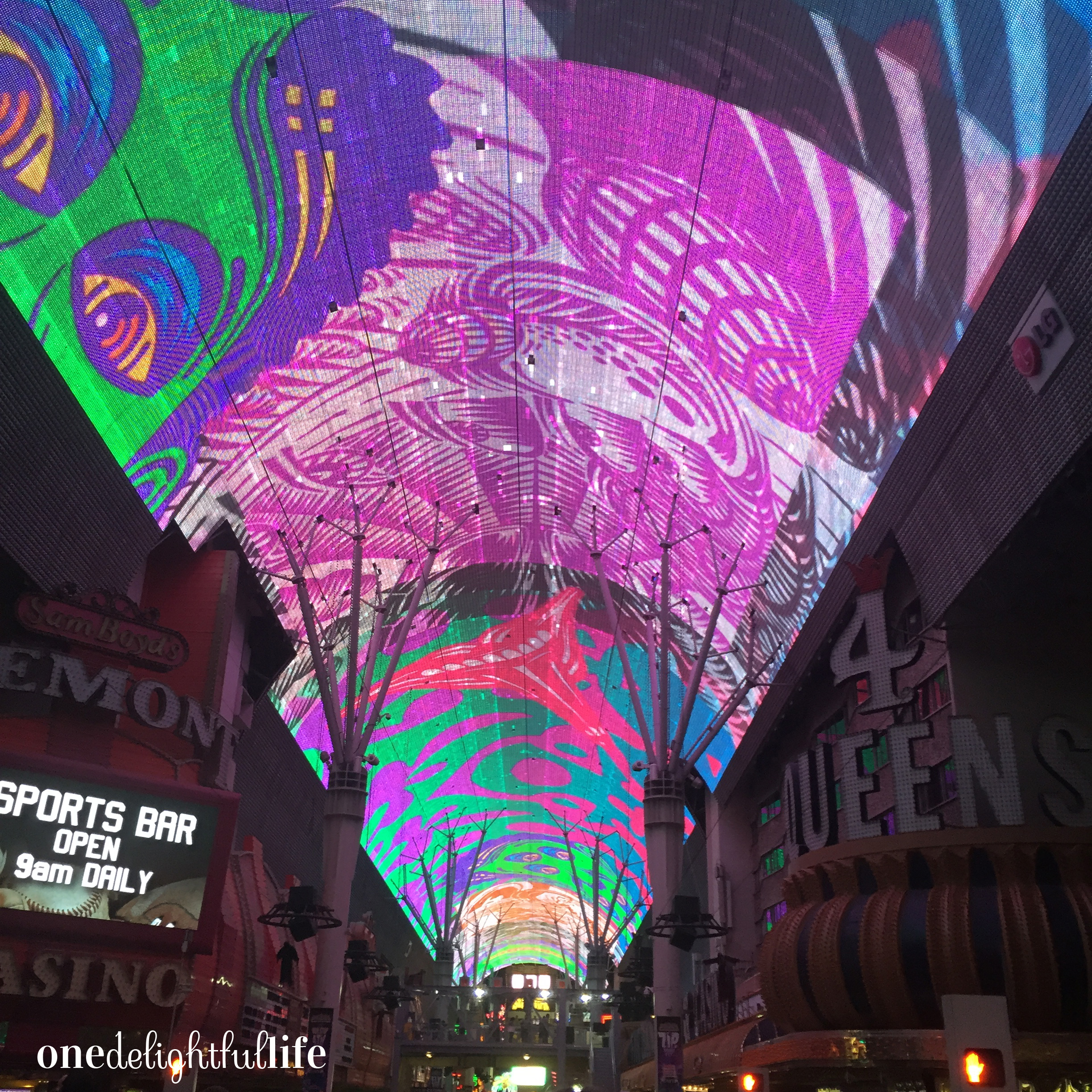 The mega LED screen over Fremont street plays a music video show every hour on the hour.